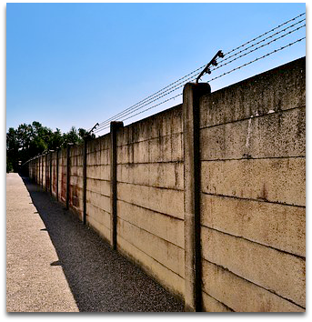 Cement wall with barbed wire