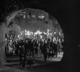 Scene from Frankenstein movie (1931)-townspeople with torches