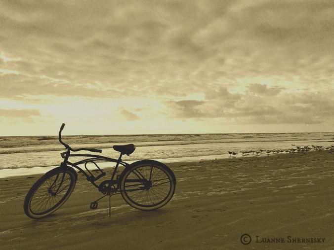 Bicycle on beach in sepia tones