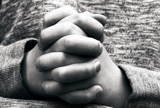 A child's praying hands