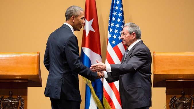 President Obama shaking hands with Raul Castro, president of Cuba.